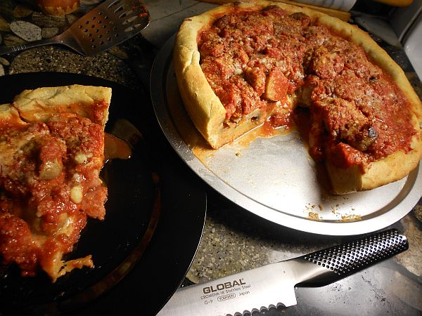 Serving Chicago Deep Dish Pizza